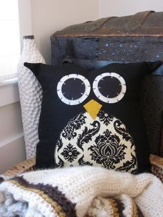The cutest owl pillows ever! She will even customize the fabrics (I have 2 of these exact ones!) - adorable and unique :)