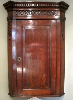 A good mid century mahogany hanging corner cupboard, with fielded panel door, dentil cornice and rare carved roundel decoration. Antique Wardrobe, Antique Cupboard, China Wall, Wall Cupboards, Corner Cupboard, Medicine Cabinets, Cornice, Panel Doors, Antique Furniture