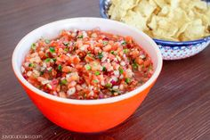 Fresh tomatoes, cilantro and lime make this ready-in-minutes homemade tomato salsa the perfect side to your next taco night or Mexican fiesta! Appetizer Dishes, Recipes Appetizers And Snacks, Desserts, Mexican Dishes, Mexican Food Recipes, Ethnic Recipes, Cooking Recipes, Healthy Recipes, Ninja Recipes