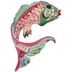 The enamel fish fur clip is marked CORO. The pot metal fish clip has puckered red lips, an enameled body that looks like scales and a blue rhinestone