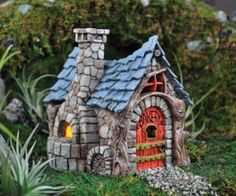 Whimsical Fairy Village | garden fairy houses Fairy garden