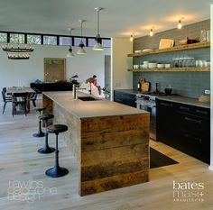 Industrial kitchen - Both rustic and modern this kitchen uses barn wood and colored subway tile.