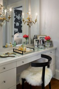 Bathroom mirror with three panels with sconces mounted in between