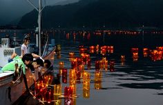PHOTO: Disaster-hit Ishinomaki casts lanterns out to sea to honor the dead/ Children release floating lanterns from a fishing boat off the coast of the Ogatsu district in Ishinomaki, Miyagi Prefecture, on Aug. 14. (Satoru Ogawa)/ ISHINOMAKI, Miyagi Prefecture--Survivors of the 2011 Great East Japan Earthquake and tsunami released lanterns out to sea Aug. 14 as part of a Bon tradition that honors the dead.