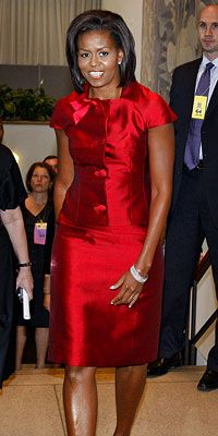 The First Lady joined her husband in New York City at the United Nations headquarters wearing a Michael Kors silk shantung suit. Mrs. Obama added diamond bangles and stud earrings to the sophisticated two-piece.