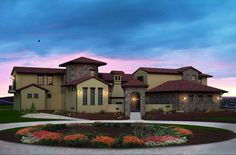 <ul>   <li>This stunning Tuscan home plan has a beautiful front courtyard with an entrance tower.</li>   <li>A circular foyer showcases the curved staircase and leads into the loggia where views of the vaulted and beamed great hall will take your breath away.</li>   <li>The gourmet kitchen has a huge island with views of the great hall fireplace in clear sight.</li>   <li>A back staircase near the home office gives you a second se...