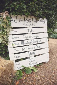 Marquee Wedding - DIY timeline painted onto a wooden pallet
