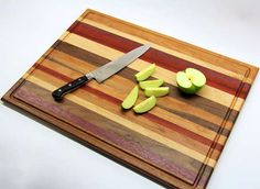 home made cutting board from scrap wood-- i have neither the tools nor the skills to make this, but if one day i have a husband who has both, i want one of these :)