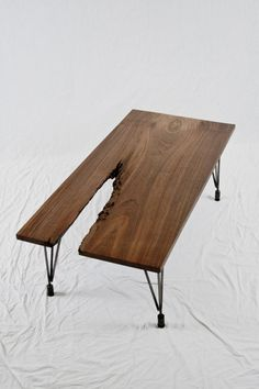 Black Walnut Abstract Coffee Table from Elpis Works on Etsy.