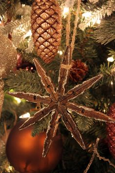 Amazing snowflake ornament made out of clothespins, twine, and glitter....Sweet Something Designs: Christmas Tree 2012