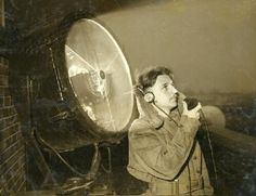 The city of St. Louis hired the first air traffic controller in the United States in 1929 to work at Lambert-St. Louis International Airport. His name was Archie W. League. In this photograph from 1933 he is using a radio and searchlight at Lambert Field. Missouri History Museum photo and prints collection. #NationalAviationDay