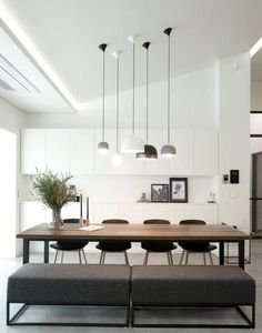 Minimal dining area with several different pendant lights to add some character