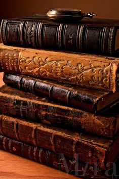 Stack of old antique books with pocket watch #antiquebooks