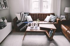 my favourite EQ3 leather couches. Love the coffee table and rug too.