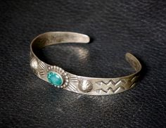 "Beautiful Old 1930s Fred Harvey Stamped Silver, Repousse and Turquoise Bracelet.There is beautiful old patina on bracelet and a great deep colored natural Turquoise Stone. Measures 6 1/2"" around inside including gap, gap is 1"" and is adjustable. Measures 1/2"" at tallest point. Weight 11.4 grams. $160.00 by FarRiderWest on Etsy"