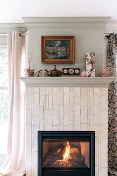"""""""A unique vertical pattern surrounds the hearth made with handmade tiles by Clayhaus Ceramics in various sizes."""""""