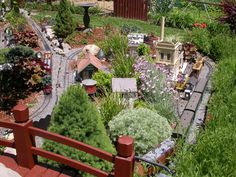 DIY Backyard Train Set running through herb garden. ~I am *SO* doing this! Although more likely with a Monorail set ;p~