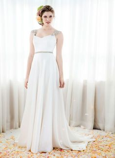 Flowing Wedding Dress In Luxurious Silk Satin With A Tailored Bodice Fully Flared Skirt And Medium Train