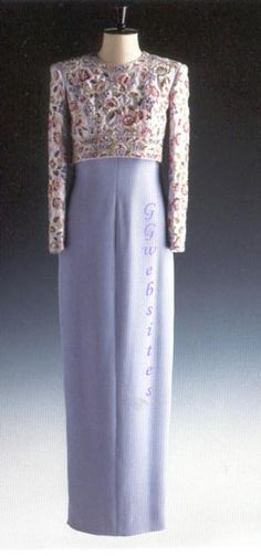 Designed by Catherine Walker, this gown was originally made of lilac raw silk on the bodice and full skirt with a bolero jacket embroidered with violets and roses and adorned with beads. Diana wore this gown in Kuwait in March 1989, and again in May 1989 to a banquet at Claridges's for a banquet for the President of Nigeria. She had it altered in 1992 to a straight lavender skirt when she wore it to a gala celebrating the Queen's golden jubilee. Lot #52 raised $ 51,750 for charity.