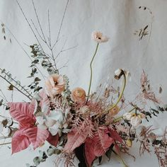 A beautiful Winter bouquet of styled wedding flowers. Masterfully created wedding decoration in beautiful red, pink and blush colors, composed of leaves, flowers and twigs. A beautiful composition and floral arrangement. Art Floral, Floral Design, Flower Studio, Flower Art, Floral Centerpieces, Floral Arrangements, Floral Wedding, Wedding Flowers, Flower Fashion