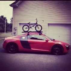 Now thats a Cool way to carry your bike!- Red Audi R8