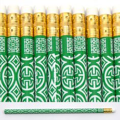{green + white patterned pencils}