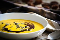 Typical Austrian pumpkin soup decorated with some pumpkin seed oil