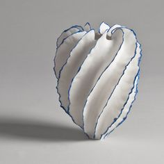 Porcelain 20 x 16cm (white with blue lining) by Sandra Davolio.                                                                                                                                                                                 More