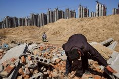 Li Rui, scavenging his former village for building materials in Liaocheng. © Justin Jin for The New York Times Socotra, Chicago School, Land Use, World Geography, China, Sustainable Development, Urban Planning, Building Materials, Ny Times