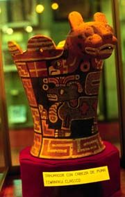 tiwanaku ceramic vessel in La Paz museum. Tiwanaku influence is notable in the ceramic arts of a large portion of the Andes. This puma vase is a Classic Tiwanaku Period artwork.