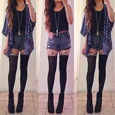 Stunning outfit. Black top, high-waisted shorts, oversized cardigan, cute heart tights and heels.