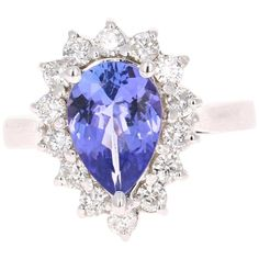 For Sale on - This ring has a simply stunning Pear Cut Tanzanite weighing Carats. The traditional ballerina setting has 14 Round Cut Diamonds that weigh carats Tanzanite Ring, Gold Engagement Rings, Bridal Rings, Round Cut Diamond, White Gold Rings, Jewelry Box, Heart Ring, Sapphire, Jewels