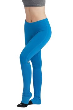 A tight and leg warmer in one, the Erid Tight should be a staple in every barre goer's wardrobe!  The enhanced moisture wicking and quick dry fabric of the tight keeps you dry and the leg warmers help to keep your muscles warm throughout class.   Wide waistband sits perfectly on your waist and flatters your figure.  Colors Offered: Atlantis, Navy, and Black  Sizes Offered: XS – L  Fit: Fitted  5'9 Model is wearing a size Medium