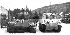 """A German Tiger II side by side with a Sherman 75mm tank. The Tiger II was captured/abandoned during fighting during the German Ardennes offensive of December 1944 known to most Americans as """"The Battle of the Bulge""""."""