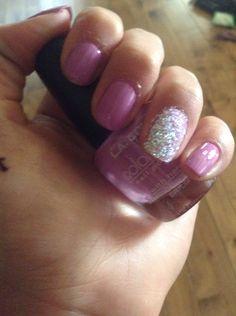 Purple glitter nail art.