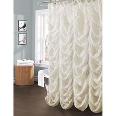 What makes the Madelynn ivory shower curtain so special is the unique texture created by the elastic embroidery detailing. The fabric is a cotton blend which is soft to the hand and drapes beautifully around the edges of your bath.