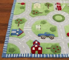 Pottery Barn Kids rug = Love this rug for my son's next room with cars/trains theme