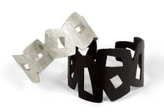 Graphic Cuffs by Jennifer Bauser. Bold and angular, these forged cuffs have a lively pattern of geometric cut-outs. Cuff #5 is bright sterling silver. Cuff #2 is available in copper with a matte black painted finish, sterling silver with bright finish, or sterling silver with oxidized finish.