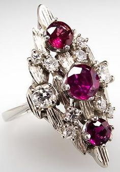 Vintage Natural Ruby & Diamond Cocktail Ring 14K White Gold. This striking vintage cocktail ring features natural rubies and diamonds in a detailed openwork setting. The ring is crafted of solid 14k white gold and is in very good condition. Via Era Gem.