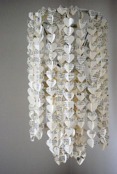 paper heart chandelier--looks like a ton of work (but cute! Book Crafts, Diy And Crafts, Arts And Crafts, Handmade Crafts, Diy Paper, Paper Art, Paper Crafts, Paper Chandelier, Crafty Craft