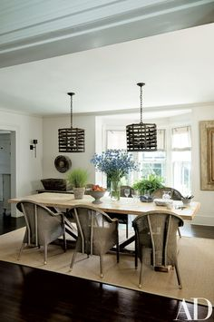 Look Inside Jon and Rebecca Bond's Stylishly Remodeled The dining room features Berns Fry ceiling fixtures; the table is from Bloom, the chairs are by Janus et Cie, and the carpet is by Merida.Hamptons Getaway Photos | Architectural Digest