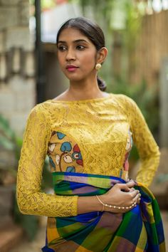 A super chic mustard blouse in cotton lace having Kalamkari side panels. Don't miss the subtle peekaboo back design. Pair with a contrasting coloured saree or a skirt. Or do an easy pairing by picking one of the colors in the Kalamkari side panels. #kalamkari #saree #india #blouse #houseofblouse