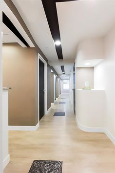 A cost-effective dental office design with neutral and clean elements. Simple, yet bold shapes and colors bring impact throughout the space. Teeth Whitening That Works, Office Waiting Rooms, Office Lobby, Dental Bridge, Dental Office Design, The Office Shirts, Hallway Designs, Portfolio Design, Architecture Design