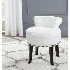 The adorable white Georgia vanity chair with silver nailhead trim is petite enough to tuck in a bathroom or bedroom.