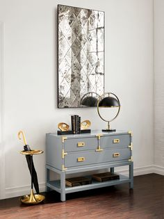 Sophisticated and chic loft entryway featuring new gray and brass Bungalow 5 products,