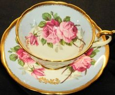 EB FOLEY ENGLAND  REGAL PINK ROSES GOLD WIDE BLUE TEA CUP AND SAUCER