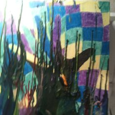 My daughter and her amazing art! Make a painting and melt your left over crayons over the top!