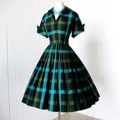 1950's. love the full skirt on this dress