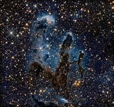Infrared view of the Pillars of Creation.   Unlike in the visible-light view, this view shows newly born stars, forming from the gas and dust in this region of space.  No wonder Sheldon is an astrophysicist on Big Bang Theory this is amazing stuff!