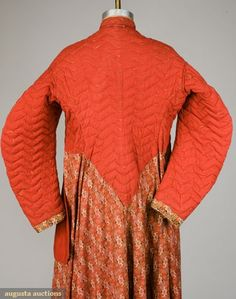"Interior view of ca. 1865 dressing gown, Augusta Auctions: Tasha Tudor Historic Costume Collection, Lot 114. ""Upper quilting for warmth. unusual double pocket on right side, torso lined in red cotton and filled with down batting (three missing buttons, tears & mends), good."